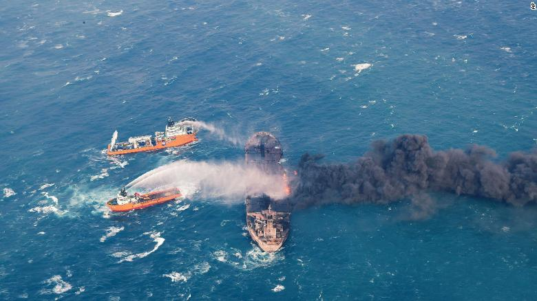 In this January 10 photo provided by China's Ministry of Transport, firefighting boats work to put on a blaze on the oil tanker Sanchi in the East China Sea off the eastern coast of China.