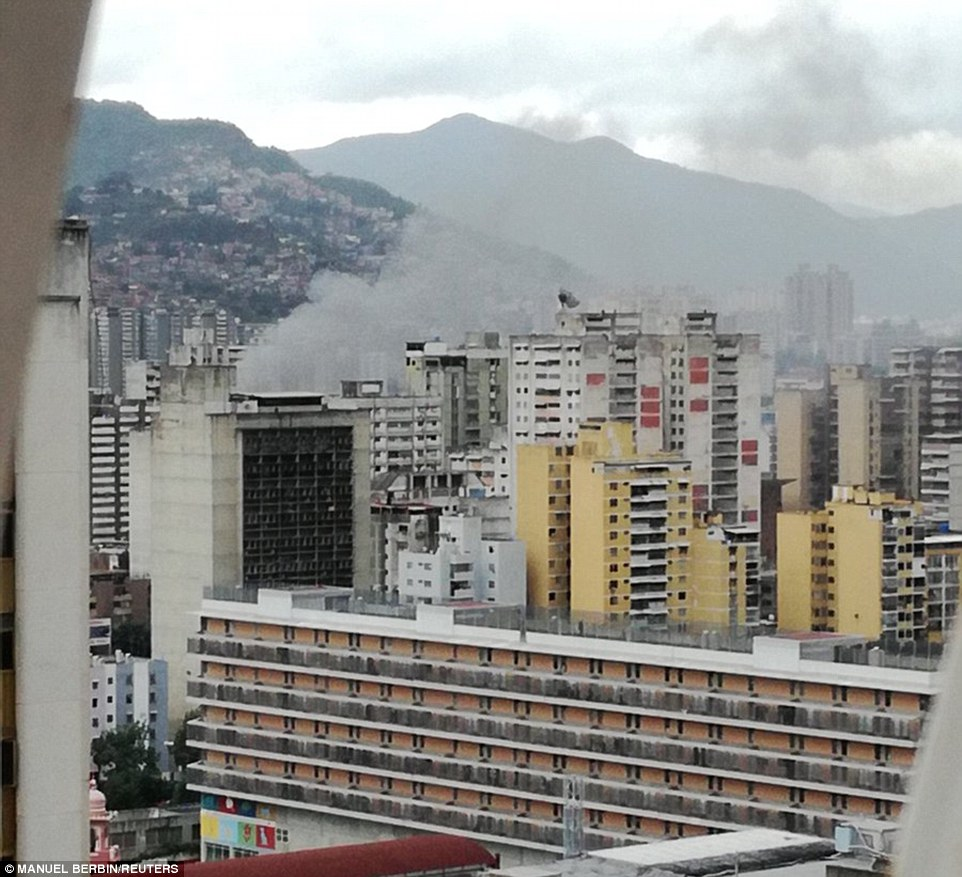 Smoke rises above the Caracas skyline after two drones detonated above the parade, according to the account Maduro gave on state TV three hours after the attack