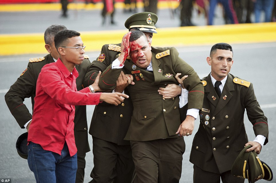 This image showed a soldier with a bleeding head (pictured) being carried away by his comrades. He was one of seven people injured