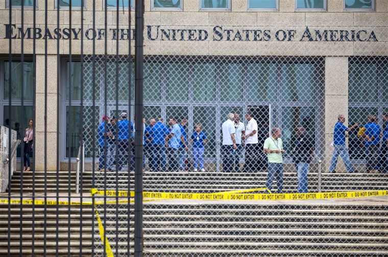 Staff stand within the United States embassy facility in Havana, Cuba on Sept. 29, 2017.