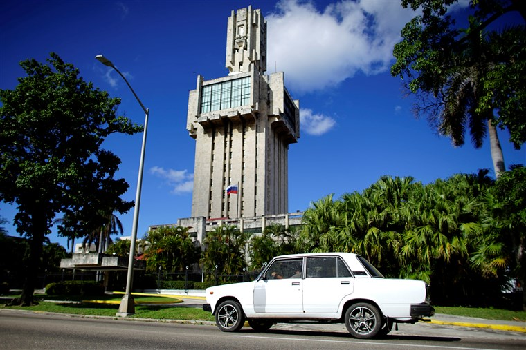 A Russian-made Lada car passes by the Russian Embassy in Havana