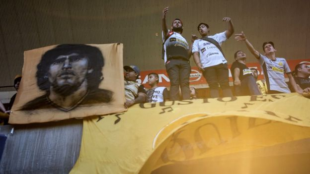 Fans cheer as they witness Diego Maradona