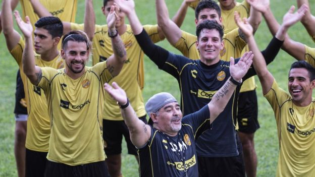 Argentine legend Diego Maradona smiles with the players during his first training session on 10 September 2018