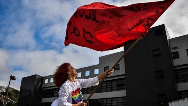 A supporter of Lula waves a Workers Part flag outside the jail in Curitiba