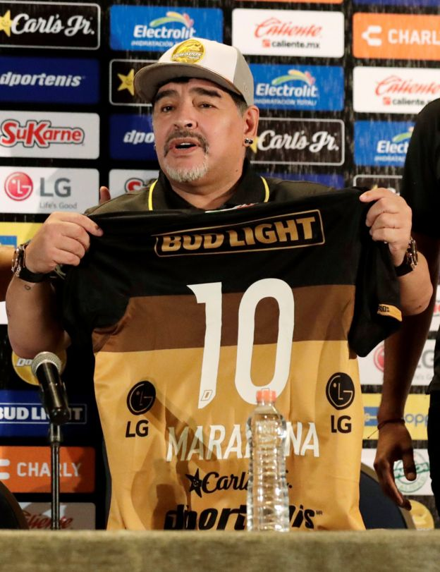Diego Maradona holds a shirt of the Dorados team with the number 10 on during a press conference, in Culiacan, Sinaloa, Mexico, 10 September 2018.