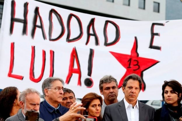 Fernando Haddad stands next to his vice presidential candidate Manuela d