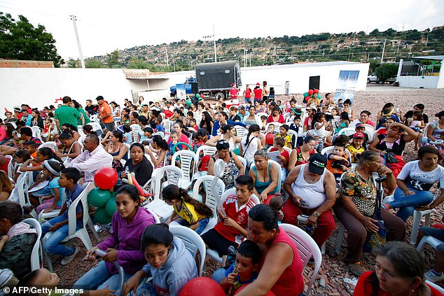Venezuelan immigrants gather in Cucuta, Colombia, on the border with Venezuela, where the Colombian Foreign Ministry is to give out gifts to Venezuelan children on Christmas Eve on December 24